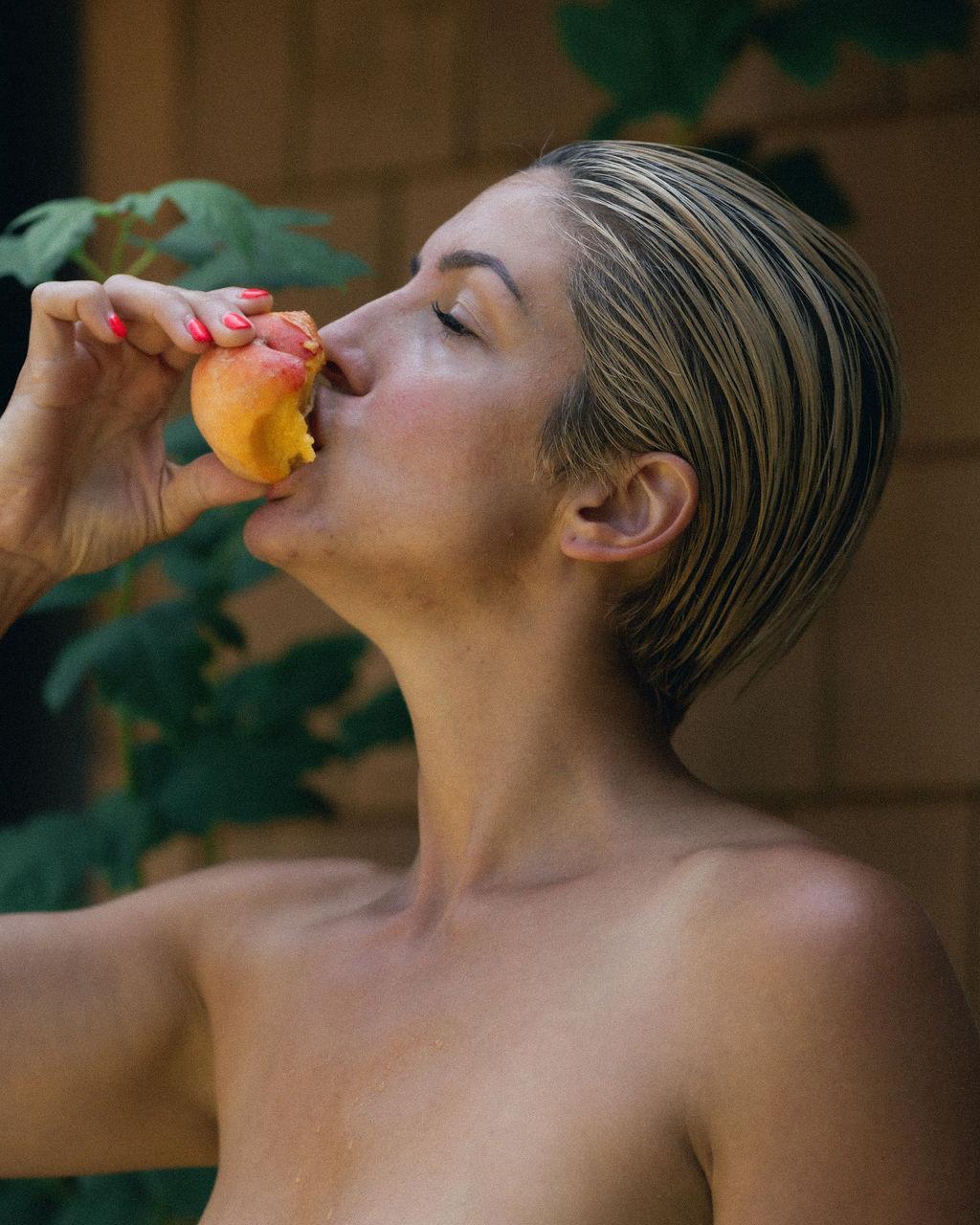 woman eating peach image